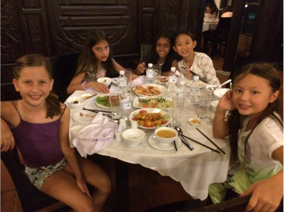 Table of girls eating local food during Hoi An trip