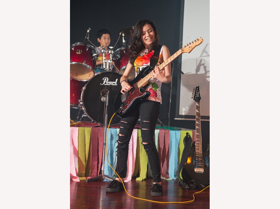 Student plays guitar Battle of the Bands 2015