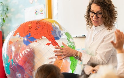 teacher with inflatable globe