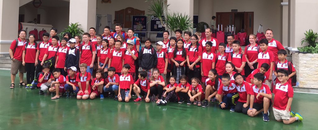 BIS HCMC Barracudas posing for photos before their trip to the Hanoi Swim Meet.