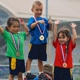 Early years children on the medal podium