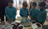 Year 2 students at the British International School Shanghai hold a bake sale to raise money to help protect the rainforest.