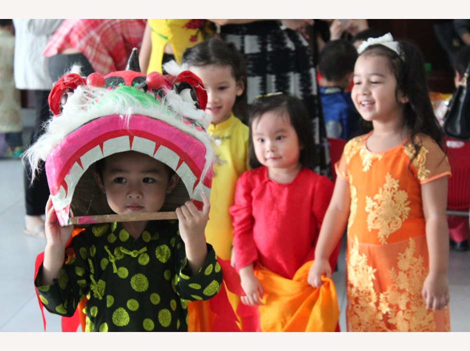 Kid in dragon dance costume
