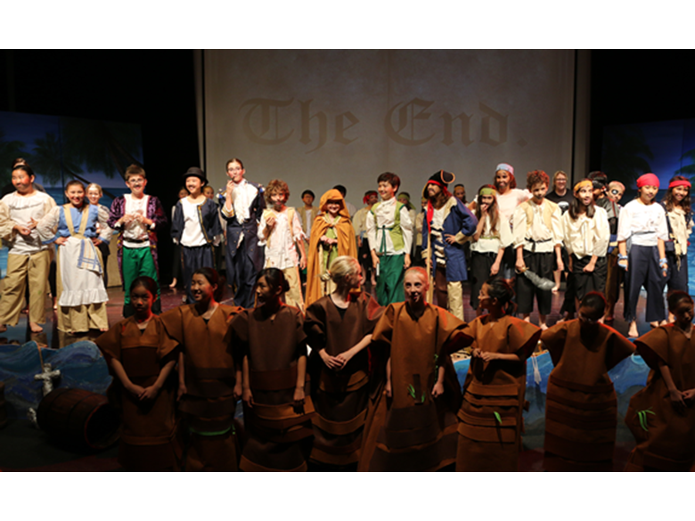 Students take a bow at the end of Treasure Island
