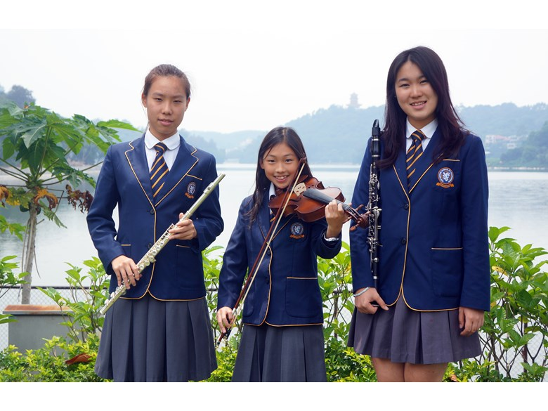 Three students with instruments
