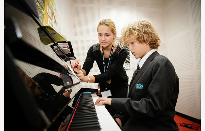 music teacher and student at piano