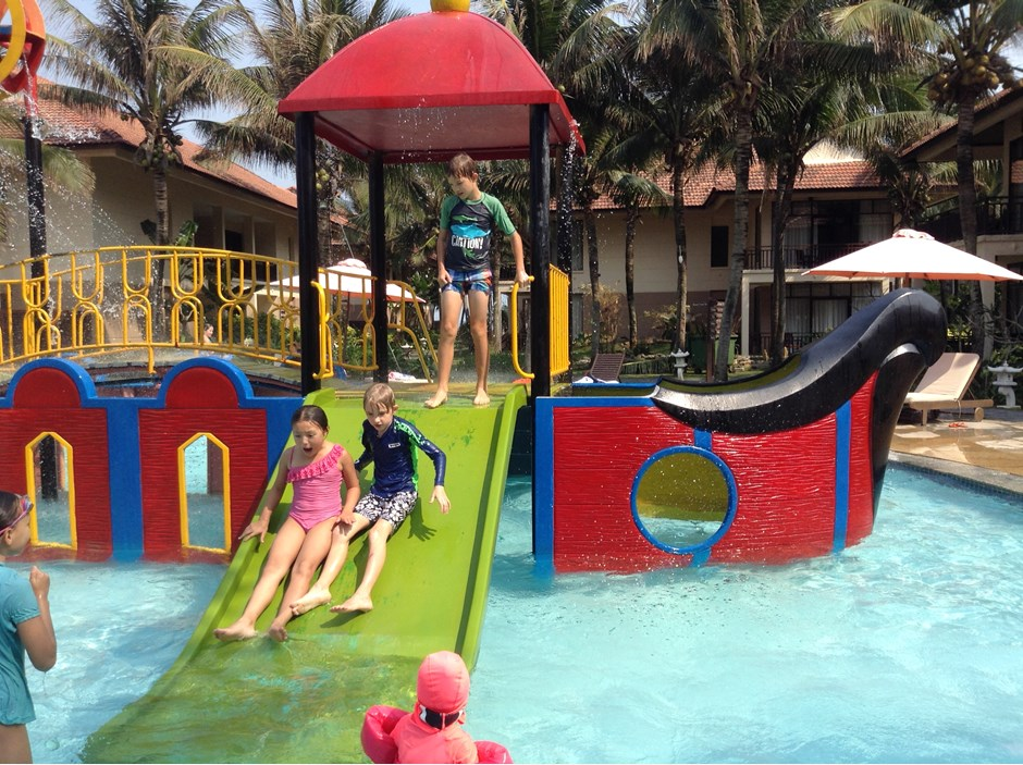 Three students playing in the water park
