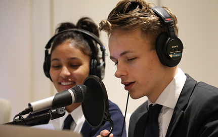 Students recording podcast