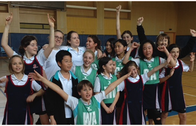 Our primary netball team celebrate their 3rd place win in their end of season tournament.