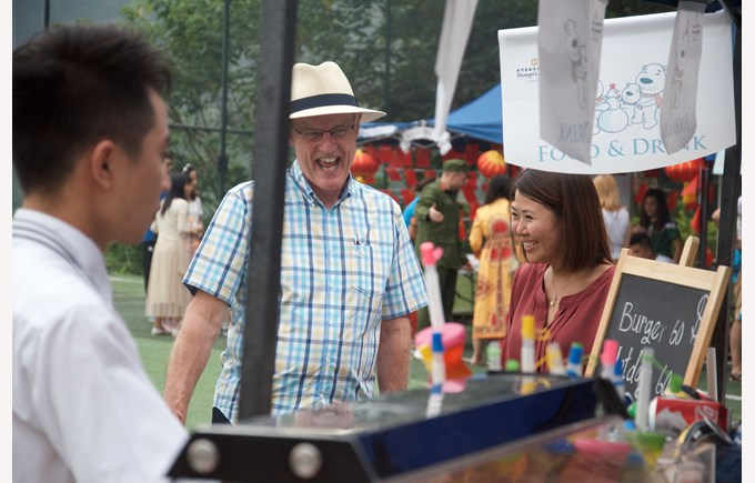 Visitors enjoying the vendor stalls at the event