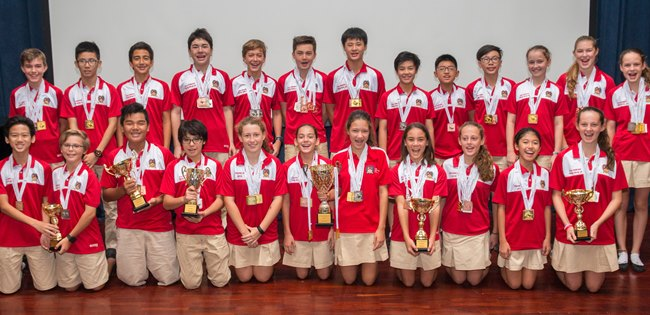 Secondary students in their red shirts with all their prizes