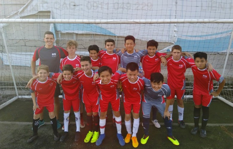 U14b boys BIS football team play EIS