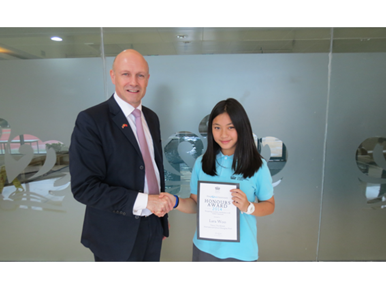 Lara Woo accepts her Honour Award from British International School Puxi Principal Kevin Foyle