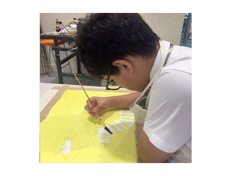 Daniel working on his Artwork