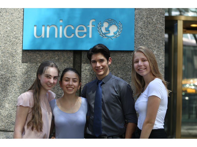 Students in front of UNICEF sign 2