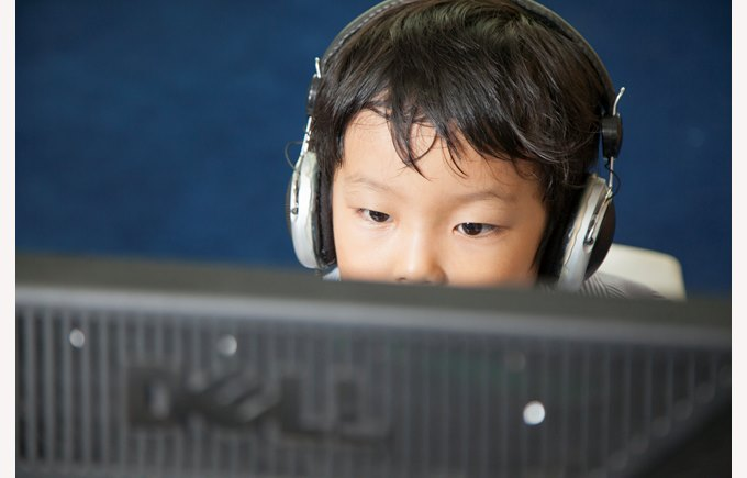student boy computer headphones