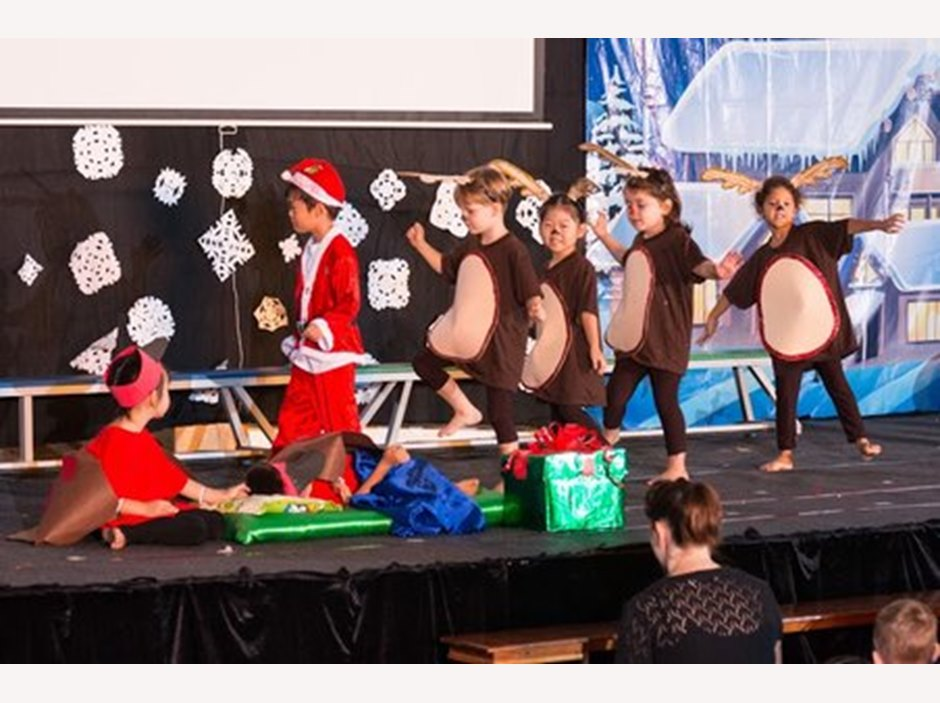 Kids dressed up as Santa and reindeer in 'Robin's So Excited' production