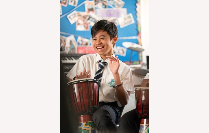 Student playing a drum
