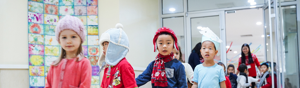 Young children leaving school in winter clothes