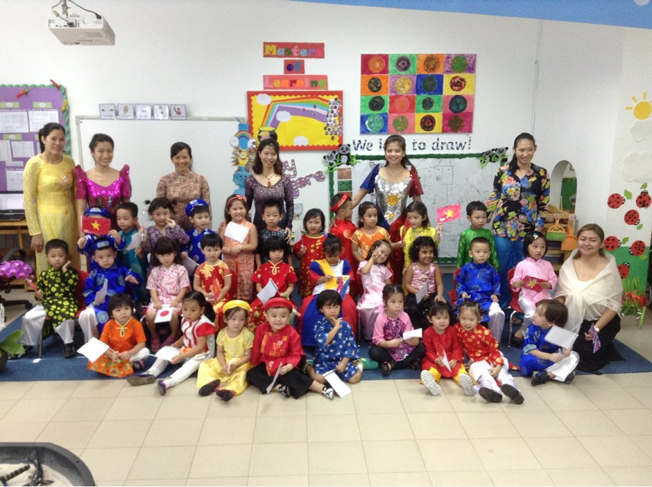 EYFS kids in traditional costume and teachers in TX International Week