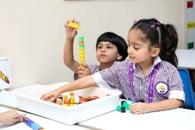 Young students with counting blocks