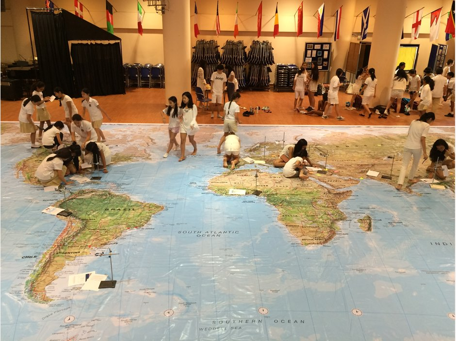 Students learning on world map