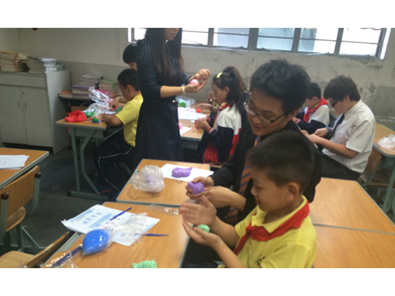 Students at the British International School Shanghai, Puxi work with students from the Qing Pu Xiu Long Migrant School during their ECA