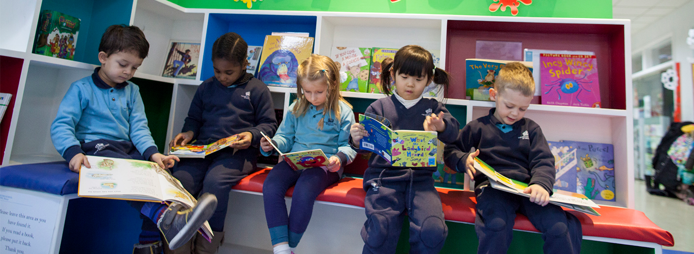 Children reading library books | NIS international school Jakarta