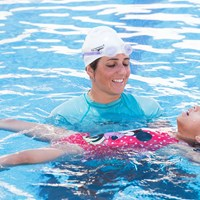 A girl learning how to swim