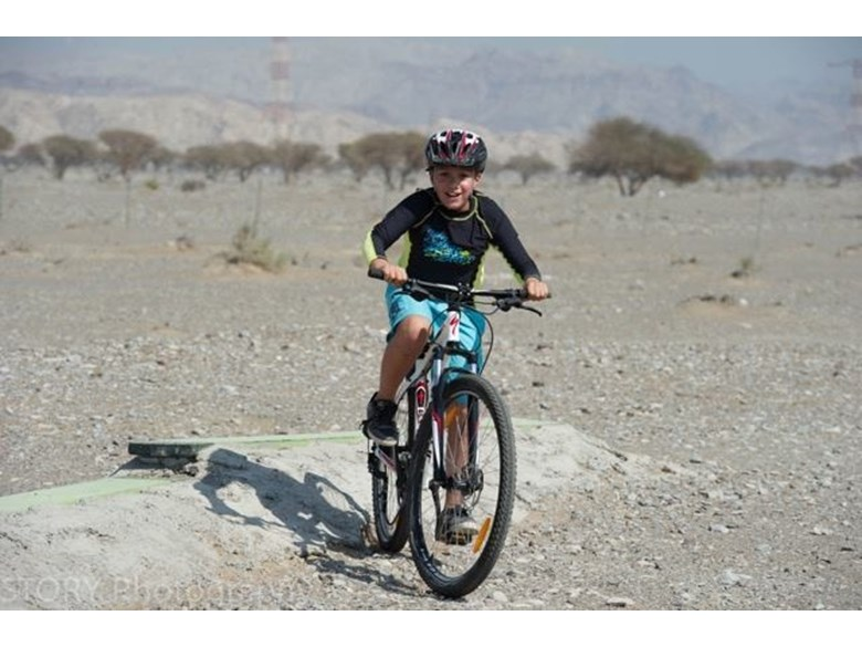 Child cycling off-road