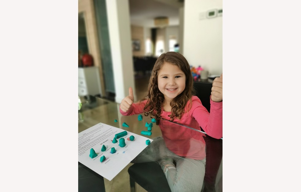 Leire making 3D shapes with playdough
