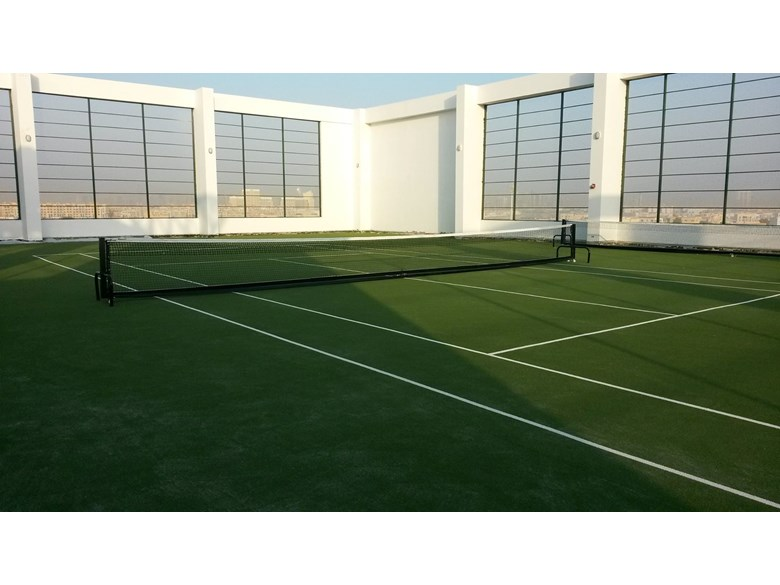 Rooftop tennis court at Nord Anglia International School Dubai