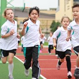 Primary students running on the front playground