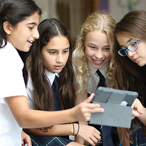 Female students looking at screen