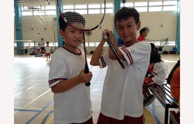 Two boys ready for badminton