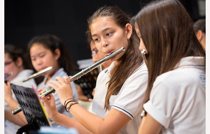 student girl playing flute
