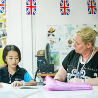 A boarding school students does her homework | Regents International School Pattaya