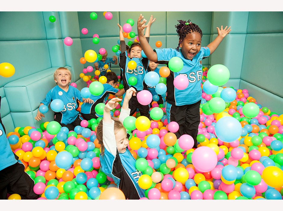 Students enjoying a play session in our indoor ball pool.
