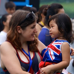 Woman holding a baby at British Day 2013.