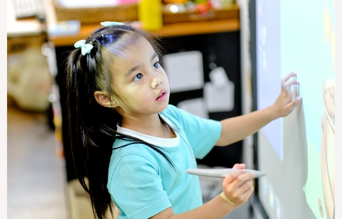 girl focused on smart board