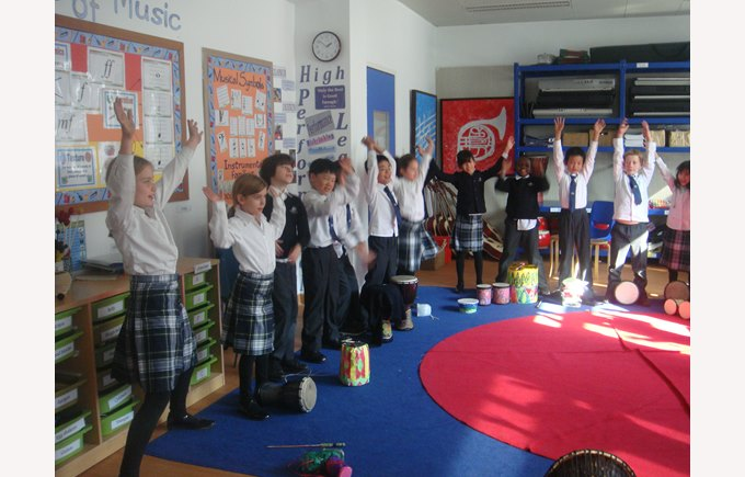 Group of Year 4 students dancing with their drums.