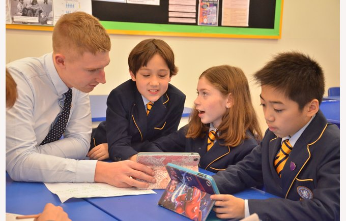 Richard Marwood interacting with students on their iPad
