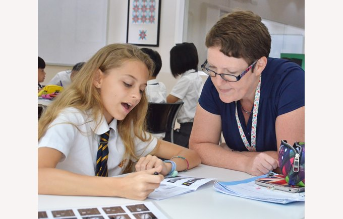 Natasha Wildy explaining a maths problem to a student