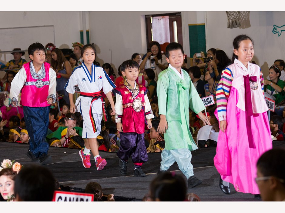 A group of Korean student parading in AP1 International Week Assembly