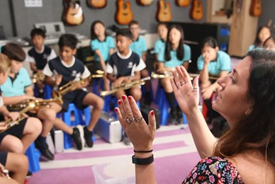 Juilliard Collaboration Music teacher clapping students engaged