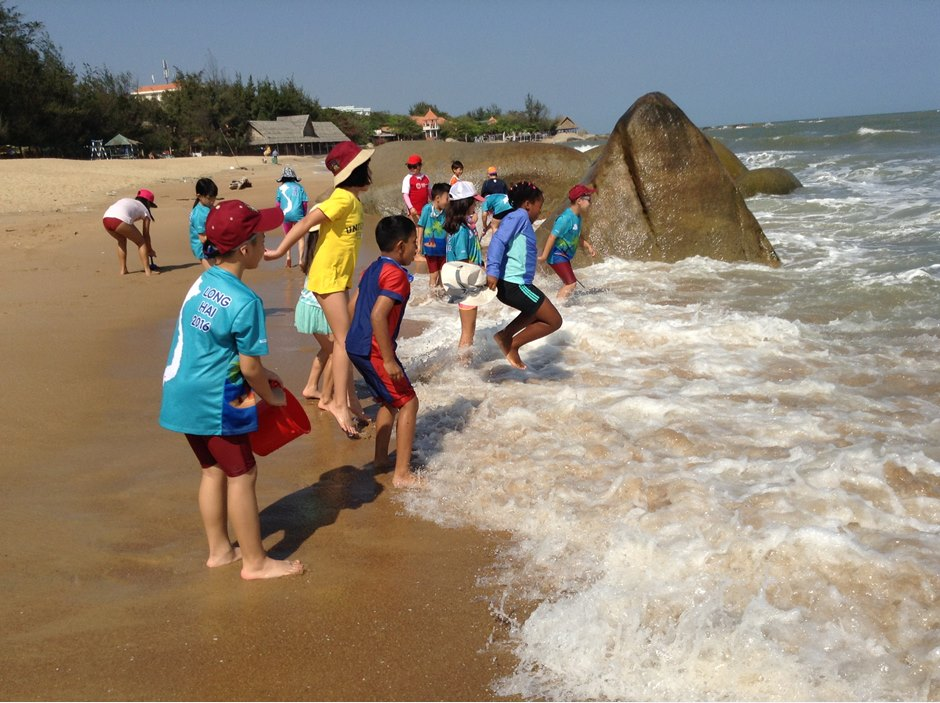 Students enjoying the waves at Long Hai