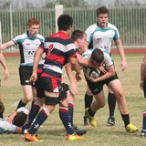 Secondary students playing rugby