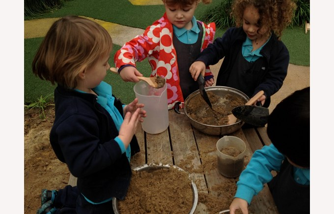Mixing in the mud kitchen