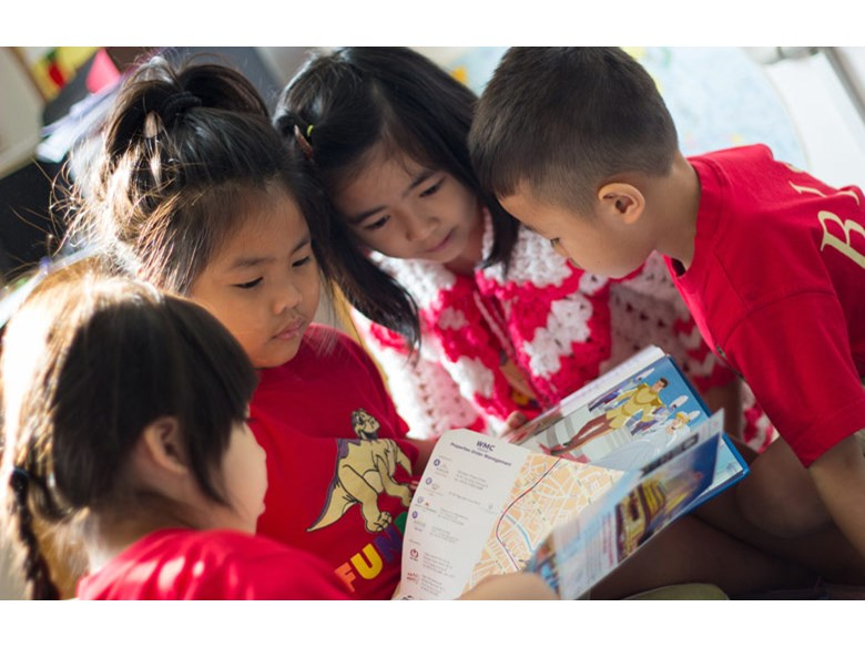 Foundation Children reading a book together at British International School, HCMC