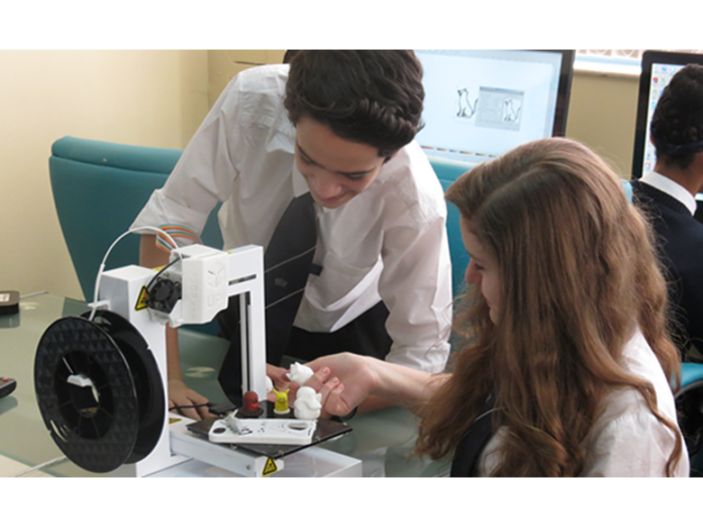 Year 9 students at the British International School Shanghai, Puxi campus with the new 3D printer